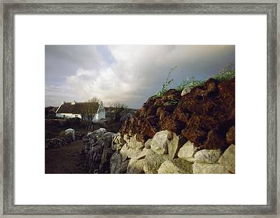 Cottage With Turf Stack, Gorumna Framed Print by The Irish Image Collection