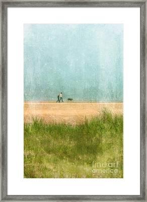 Couple On Beach With Dog Framed Print by Jill Battaglia