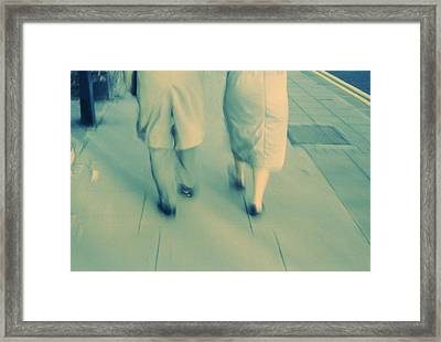 Couple Walking Framed Print by Kevin Curtis