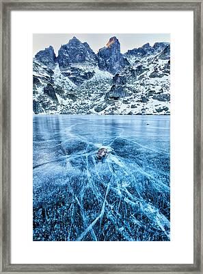 Cracks In The Ice Framed Print by Evgeni Dinev