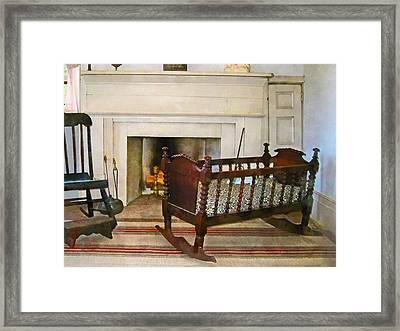 Cradle Near Fireplace Framed Print by Susan Savad