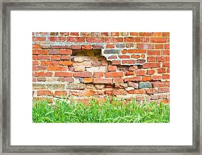 Crumbling Wall Framed Print by Tom Gowanlock