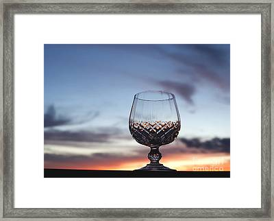 Crystal Glass Against Sunset Framed Print by Blink Images