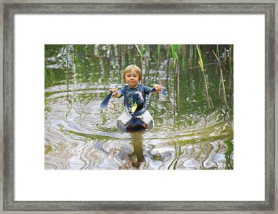 Cute Tiny Boy Riding A Duck Framed Print by Jaroslaw Grudzinski