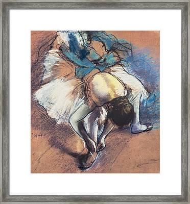 Dancer Fastening Her Pump Framed Print by Edgar Degas