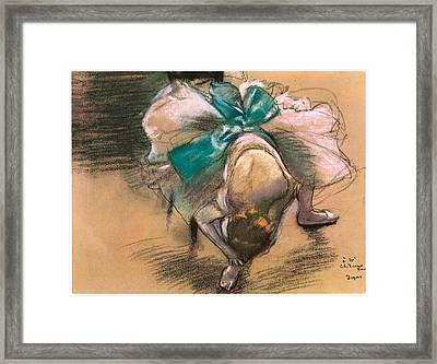 Dancer Tying Her Shoe Ribbons Framed Print by Edgar Degas