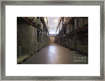Dark Warehouse Aisle Framed Print by Magomed Magomedagaev