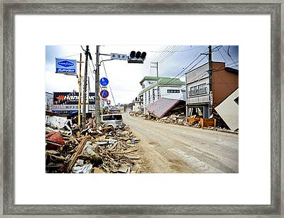 Debris Rubble And Damaged Vehicles Line Framed Print by Everett
