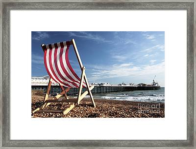 Deckchair On Brighton Beach Framed Print by Neil Overy
