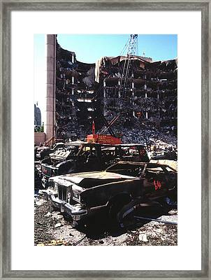 Destroyed Automobiles Near The Bombed Framed Print by Everett