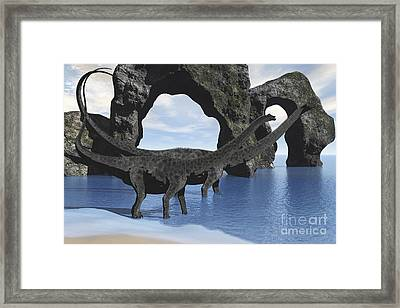 Diplodocus Dinosaurs Wade Framed Print by Corey Ford