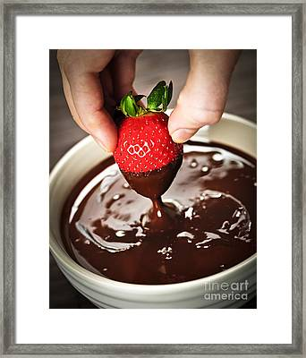 Dipping Strawberry In Chocolate Framed Print by Elena Elisseeva