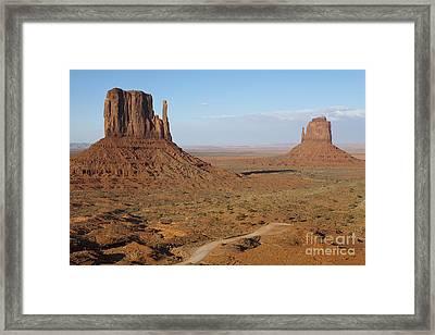 Dirt Road And Mesas In The Desert Framed Print by Paul Edmondson