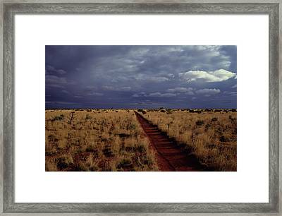 Dirt Road In A Flat Landscape Framed Print by Medford Taylor