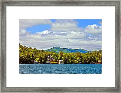 Distant Lake View In Spring Framed Print by Susan Leggett