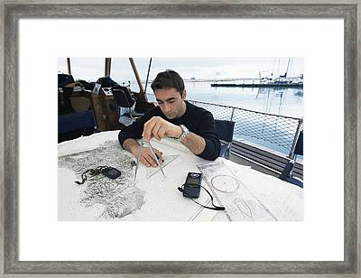 Diver Plotting A Course Framed Print by Alexis Rosenfeld