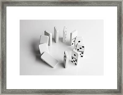 Dominoes In A Circle Beginning To Fall Over In A Chain Reaction Framed Print by Larry Washburn
