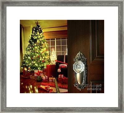 Door Opening Into A Christmas Living Room Framed Print by Sandra Cunningham