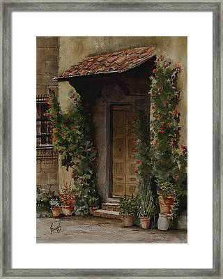 Door With Roses Framed Print by Sam Sidders