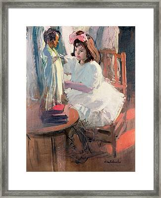 Dressing Her Doll Framed Print by Claudio Castelucho