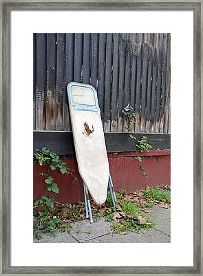 Dumped Ironing Board Framed Print by Carlos Dominguez