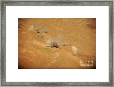 Dust Rises From The Impact Points Of Kp Framed Print by Stocktrek Images