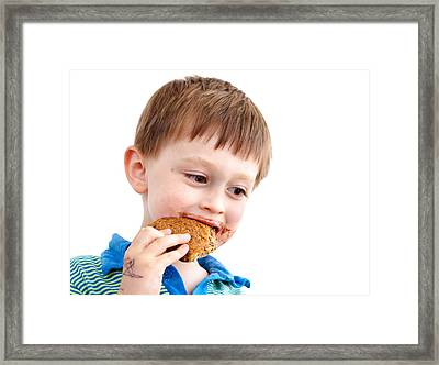 Eating Biscuit Framed Print by Tom Gowanlock
