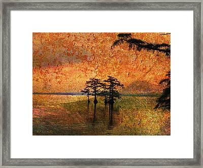 Eerie Sunrise  Framed Print by J Larry Walker