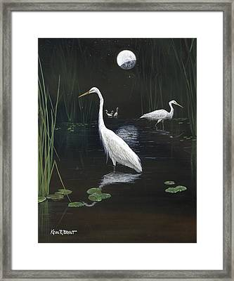 Egrets In The Moonlight Framed Print by Kevin Brant