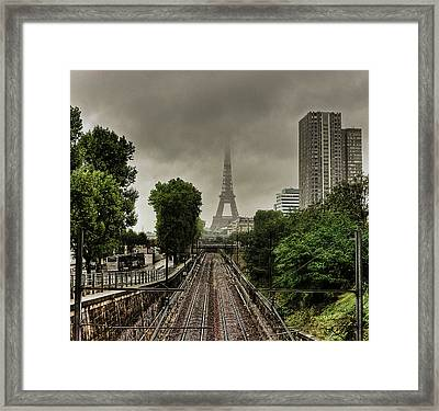 Eiffel Tower In Clouds Framed Print by Stéphanie Benjamin