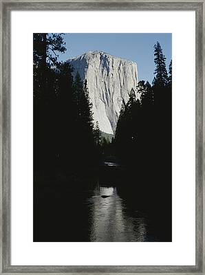 El Capitan Soars Above The Merced River Framed Print by Marc Moritsch
