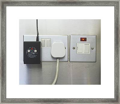 Electrical Plugs Framed Print by Carlos Dominguez