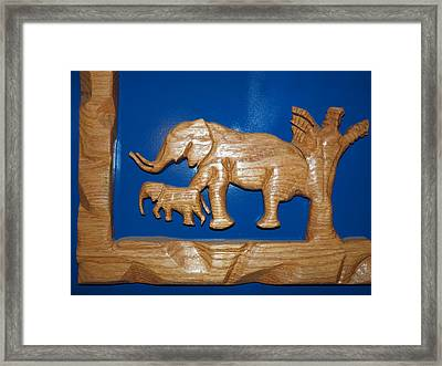Elephant Doing Time Framed Print by Robert Margetts