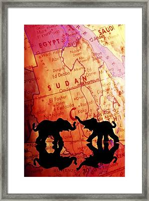 Elephant Silhouettes In Front Of A Map Framed Print by Chris Knorr