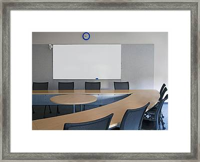 Empty Boardroom Or Meeting Room In An Framed Print by Marlene Ford