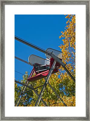 Empty Chair On Ferris Wheel Framed Print by Thom Gourley/Flatbread Images, LLC