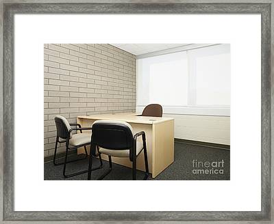 Empty Desk In An Office Framed Print by Skip Nall