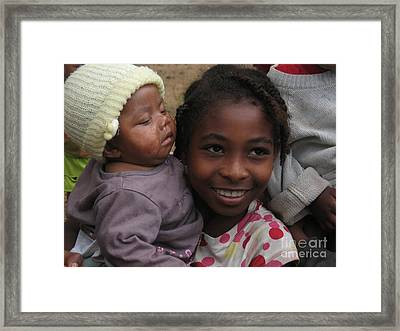 Enfants A Madagascar Framed Print by Francoise Leandre