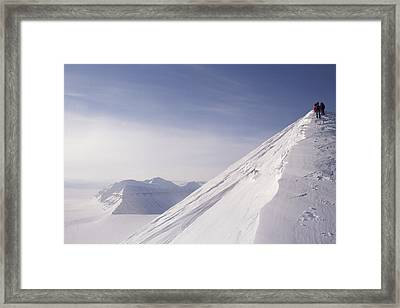 Expedition Skiers Climb Nemtinov Peak Framed Print by Gordon Wiltsie