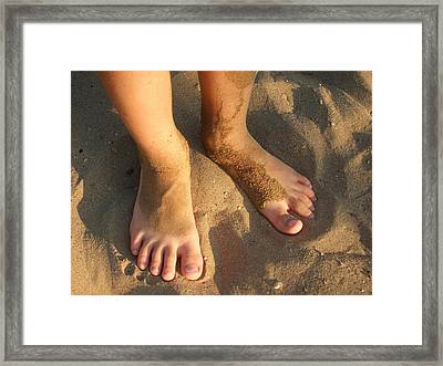 Feet Of A Child In The Sand Framed Print by Matthias Hauser