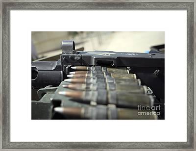 Fifty-caliber Machine Gun Rounds Framed Print by Stocktrek Images
