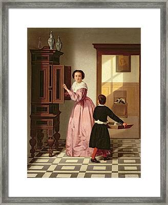 Figures In A Laundryroom Framed Print by Gustaaf Antoon Francois Heyligers