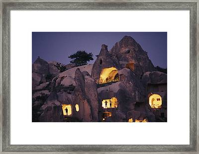 Figures Stand In The Doorways Framed Print by Jonathan Blair