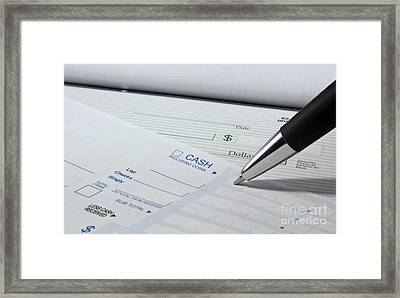 Filling Out Deposit Slip Framed Print by Blink Images