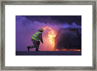 Firefighter Tackling A Burning Car Framed Print by Duncan Shaw