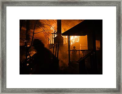 Firefighters Spray Down A Burning House Framed Print by Mark Thiessen