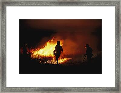 Firefighters Start A Controlled Fire Framed Print by Joel Sartore
