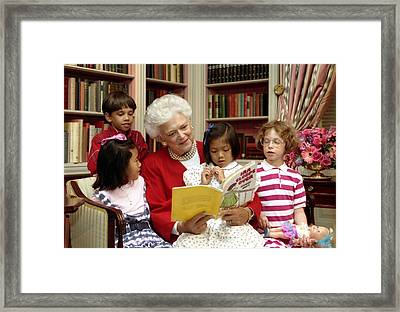 First Lady Barbara Bush Reads Framed Print by Everett