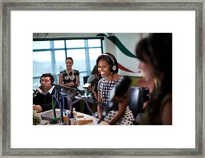 First Lady Michelle Obama Does An Framed Print by Everett