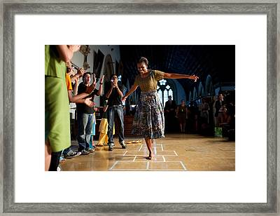 First Lady Michelle Obama Plays Framed Print by Everett